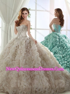 Unique Puffy Skirt Brush Train Beaded Champagne Quinceanera Gown in Rolling Flowers