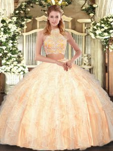Unique Peach Two Pieces Tulle Halter Top Sleeveless Beading and Ruffles Floor Length Criss Cross Quinceanera Gowns